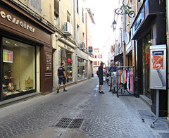 Isle sur la Sorgue (AmyEAnderson) Tags: outdoor shops magasins islesurlasorgue provence vaucluse france europe people buying goods clothing asvp police town historic village