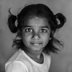 Eyes (Ravikanth K) Tags: portrait people blackandwhite india cute girl monochrome look bigeyes pig kid eyes child outdoor indian headshot curious chennai tamilnadu tails cwc 500px chennaiweekendclickers
