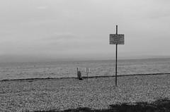 Vietati Ombrelloni e Sdraio Privati (carlo.picotti) Tags: marinajulia italia friuli italy mare sea spiaggia beach divieto cartello salvagente blackandwhite biancoenero bn bw fuji fujifilm fujix x30