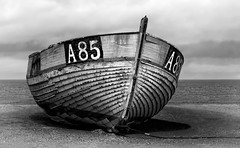 A Battered Boat (Inge Vautrin Photography) Tags: ocean old sea sky blackandwhite monochrome clouds denmark outside outdoors boat fishing sand europe rope northsea scandinavia fishingboat danmark battered scrapped vesterhavet thorupstrand