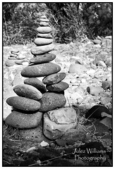 Rock Cairn (juliewilliams11) Tags: blackandwhite monochrome photo border outdoor rock cairn bush