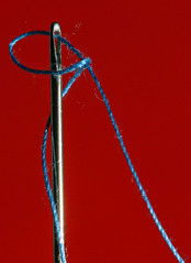 Needle & Thread (2) (1selecta) Tags: needle thread red reddish blue metal metalic macro closeup near threaded twisted flowing eye