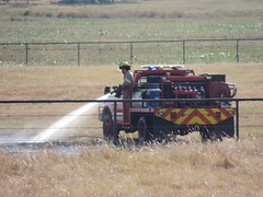 Fire in the Farmland (Andrew Penney Photography) Tags: fire farm country firetruck flames grass oklahoma water spray putout fireman firefighters rural squirting tractor deercreek firemen fireboys volunteers farmerted