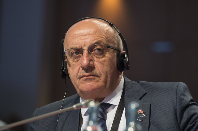 Yahya Baş listening to the Open Ministerial Session