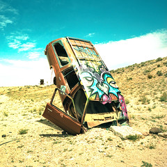 we reap what we sow. goldfield, nv. 2016. (eyetwist) Tags: old 6 art chevrolet abandoned 120 6x6 mamiya film church station last contrast analog mediumformat square wagon 50mm graffiti town xpro crossprocessed saturated junk rust cross desert kodak buried decay crossprocess tag nevada ghost rusty ishootfilm chevy ghosttown junkyard analogue gasoline mamiya6 process wreck ektachrome processed e100vs stationwagon mojavedesert caprice goldfield emulsion planted kodakektachromee100vs 100vs lenstagger eyetwist 6mf mamiya6mf ishootkodak epsonv750pro recentlyprocessedfilm eyetwistkevinballuff wereapwhatwesow carforest crossprocessede6toc41 mamiya50mmf4l internationalcarforestofthelastchurch
