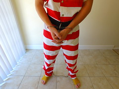 Red Striped Prisoner (boblaly) Tags: handcuffs restraints cuffs cuffed handcuffed inmate uniform prisoner jumpsuit prison jail tubes detention belly chain