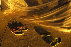 slippers, a bottle of milk and refugee camps Refugees Afganistan Sudan Pakistan Somalia Unhcr Immigrants Streetphotography Nightshot Stock Photo People Children Daily Life Bestoftheday (KanuaBlack) Tags: refugees afganistan sudan pakistan somalia unhcr immigrants streetphotography nightshot stockphoto people children dailylife bestoftheday