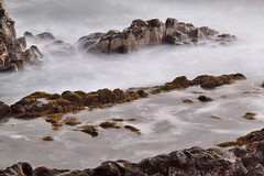 Between the sea and rocks (Beatriz-c) Tags: sea mar rocks rocas landscape litoral coast costa long exposition larga exposicin paisaje exposure