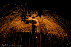 Bringing own light to darkness (judethedude73) Tags: light wirewoolspinning photography fun art nighttimephotography golden orange sparkle sparks