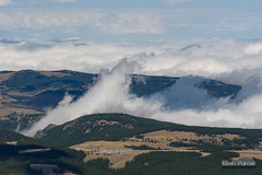 Waves of Clouds (kevin-palmer) Tags: wyoming september fall autumn nikond750 nikon180mmf28 blackmountain clouds summit bighornmountains bighornnationalforest cloudscapes highway14 trees telephoto peak scenic view laborday