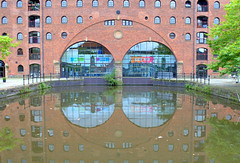 Key 103 reflections at Castlefield, Manchester (Tony Worrall) Tags: english northern england uk update place location north visit area county attraction open stream tour country welovethenorth northwest unitedkingdom gmr manchester manc city architecture building outside outdoors castlefeild reflection wetreflection arch windows wet water canal radio station urbanheritagepark