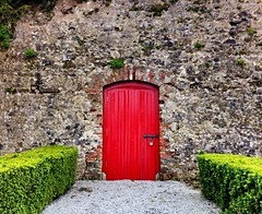 The Red Door (JulieK (thanks for 8 million views)) Tags: door ireland red irish wall countryside cork scenic hdr munster walledgarden donerailepark iphone4 uploaded:by=flickrmobile flickriosapp:filter=nofilter