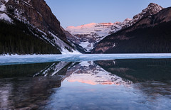 First Rays (SoumyaB@nerjee) Tags: sun lake snow canada reflection ice sunrise reflections rockies frozen nikon louise alberta rays d610 1635mm firstrays
