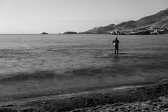 El pescador (Eduardo Estllez) Tags: espaa costa naturaleza blancoynegro horizontal monocromo mar agua mediterraneo natural paisaje litoral olas almeria cabodegata acantilado rocas pescador montaas pescando nadie fosil volcanico parquenatural escullos escarpado lugaresdeinteres eduardoestellez estellez destinosturisticos