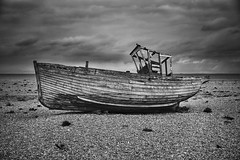 Another Abandoned Boat (A Guy Taking Pictures) Tags: sea england sky white black abandoned weather dark coast boat ship stones south stormy east dungeness another hdr