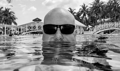 Posing  the pool way. (CWhatPhotos) Tags: pictures sky sun white holiday black hot water pool june digital swim pose that island four photography mono hotel glasses cool day skies foto image artistic time pics cuba sunny pic olympus images shades wear clear have tryp photographs coco photograph fotos cuban which contain cayo hols monochome 2016 hirds hoteltryp hoteltrypcayococo cwhatphotos