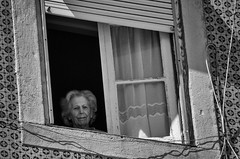 'The Shadow of Your Smile' (for Fan Ho) (Canadapt) Tags: street portrait woman portugal window lisbon frame elder shutter blinds curtains alfama fanho canadapt