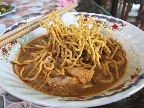 One of the best Khao Soi's in the world (Best one in Chiang Mai, but because Chiang Mai is the Khao Soi city I'd say the world).   The place is called ข้าวซอยคุณยาย (Translates to Grandmothers Khao Soi if I remember correctly) located at the North Part of