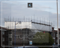 Residential roof repair scaffold encapsulation - Tufcoat Shrink Wrap