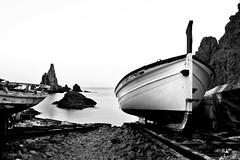 La soledad compartida (RalRuiz) Tags: longexposure blackandwhite espaa blancoynegro mar andaluca barca almera cabodegata mediterrneo edicin largaexposicin procesado acantiladodelassirenas