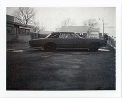 Fort Wayne, IN (moominsean) Tags: car vintage polaroid midwest dusk indiana instant 190 fortwayne dealer type667 expired102009