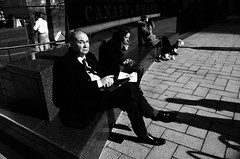 Three On the Bench (maxgor.com) Tags: leica people blackandwhite london candid streetphotography canarywharf londonstreet rawstreets maxgor maxgorcom