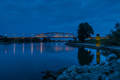 Bridge over still waters (Robert Stienstra Photography) Tags: bridge bridges dutchbridges blue hour bluehour bluehourphotography riverscape dutchriver westervoort longexposure longexposurephotography landscape landscapes dutchlandscapes outdoor nikond7100 tamron18200mm nightscapes cityscape cityscapes reflection reflections