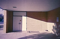 Breezeway #2 (rileymillion) Tags: school shadow building architecture bench concrete doors 35mmfilm disposablecamera analogphotography lateafternoon breezeway adamselementary colorfilm color35mm
