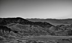 Badland Formations of Golden Canyon (Black & White) (thor_mark ) Tags: california day2 sunset mountains nature blackwhite unitedstates deathvalley blueskies goldencanyon desertlandscape lookingwest deathvalleynationalpark nearsunset sunsettime project365 colorefexpro erosionallandscape tuckimountain mountainsindistance silverefexpro2 badlandformations nikond800e mountainsoffindistance amaragosarange capturenx2edited triptodeathvalleyandcalifornia westgreatbasinranges atzabriskiepoint