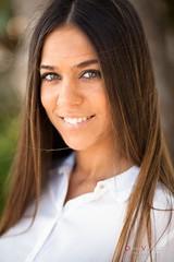 Sonrisa cmplice (Dani_vr) Tags: portrait smile hair corua tan viento galicia sonrisa belleza pelo morena tanned ferrol melena