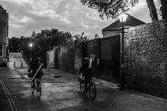 Cyclists (Jonny Rowlands) Tags: street light white black art lamp monochrome bicycle night corner river cyclists evening alley nikon angle path cam 14 wide sigma f cycle 24mm camb d7000