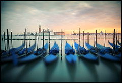the blue boats (biancavanderwerf) Tags: city travel blue venice sunset italy color colour water river boats turqouise nd gondola bianca longshutter turkoois