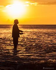 The Fisherman at Sunset (ericbphotoworks) Tags: sunset orange sun beach water silhouette hawaii fishing fisherman oahu cigarette hawaiian