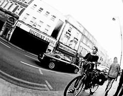 London Discount (kirstiecat) Tags: uk greatbritain england woman london bike female europe unitedkingdom stranger gb bicyclist fisheyelens monochromemonday