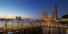 Uitzicht over de Maas (zsnajorrah) Tags: urban architecture skyscraper highrise skyline bridge water river jetty sky bluehour twilight dusk night wideangle ultrawideangle uwa longexposure 7dmarkii efs1018mm netherlands rotterdam maas erasmusbrug erasmusbridge kopvanzuid wilhelminapier worldportcenter montevideo neworleans derotterdam hotelnewyork hny maastoren