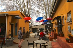 Parys again... (peet-astn) Tags: freestate parys southafrica umbrella umbrellas colour colourful orange shops