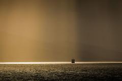 Mull - Oban Ferry (alancookson) Tags: fujixt1scotland mull oban ferry caledonianmacbrayne crepescular rays