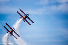 wing walkers (jason hackett) Tags: planes stunts wings walkers sky blue smoke clouds amazing display