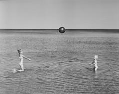 Z&N (Maciek Lesniak) Tags: daughters mediumformat film filmisnotdead buyfilmnotmegapixels sea playing ball blackwhite relax children