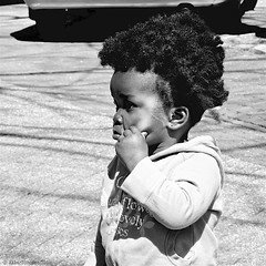 Pinching... (Akbar Simonse) Tags: street people bw holland blancoynegro netherlands monochrome square kid zwartwit candid nederland streetphotography bn thehague vierkant lahaye sgravenhage agga straatfotografie dscn1843 akbarsimonse