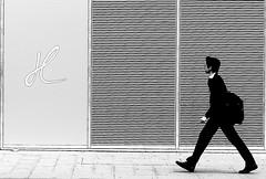 With long strides (pascalcolin1) Tags: blackandwhite bag noiretblanc sac streetview paris13 photoderue strides urbanarte photopascalcolin enjambes