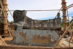 Lake Toba - Ancient Batak Tomb being Restored (Drriss & Marrionn) Tags: travel sumatra indonesia skull outdoor tomb sarcophagus restoration batak laketoba radja samosir simanindo ambarita bataktomb