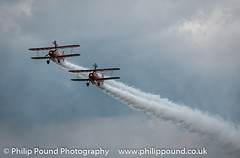Breitling Wingwalkers (Philip Pound Photography) Tags: plane airplane flying hill flight boeing biplane biggin stearman breitling wingwalker festivalofflight