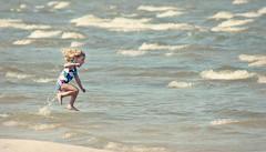 Yee-haw! (Kim's Pics :)) Tags: summer canada hot beach water girl sunshine childhood fun jumping day waves child joy manitoba midair grandbeach splashing coolingoff whitecaps