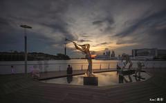 Sunset @Sentosa Boardwalk (Ken Goh thanks for 2 Million views) Tags: sunset sky orange cloud sun reflection water silhouette buildings singapore pentax smooth sigma boardwalk sentosa 1020 k1 citiscape