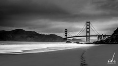 Footsteps to the Golden Gate (anoopbrar) Tags: ocean sanfrancisco california city longexposure bridge urban bw usa art beach nature water monochrome architecture night clouds america buildings reflections landscape bay landscapes blackwhite san francisco long exposure unitedstates artistic outdoor dusk cities bridges sanjose goldengatebridge goldengate citylights baybridge sanfran darkclouds foreground landscapephotography cali49a cloudsstormssunsetssunrises