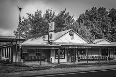 Leona General Store (Mike Schaffner) Tags: blackandwhite bw monochrome bench us blackwhite texas unitedstates bell flag seats generalstore leona cocacolasign