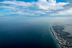 miami beach (almostsummersky) Tags: ocean above travel sky beach clouds plane buildings airplane fly us flying spring haze waves shadows view unitedstates florida miami northbeach tropical miamibeach atlanticocean current southbeach humid upintheair midbeach