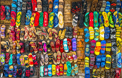 Sometimes all you need is a splash of colour (G. Cordeiro) Tags: nepal colour shop wall rainbow thongs flipflops colourful slippers jandals