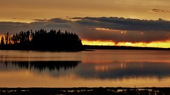 Sunset in May (krystyna_piw) Tags: park trees light sunset orange cloud brown sun lake canada reflection tree beautiful yellow clouds landscape island photography spring may calm shore alberta woda nwn elkislandpark jezioro chmury pomaraczowy plaa zachdsoca wyspa wybrzee astotinlake world100f